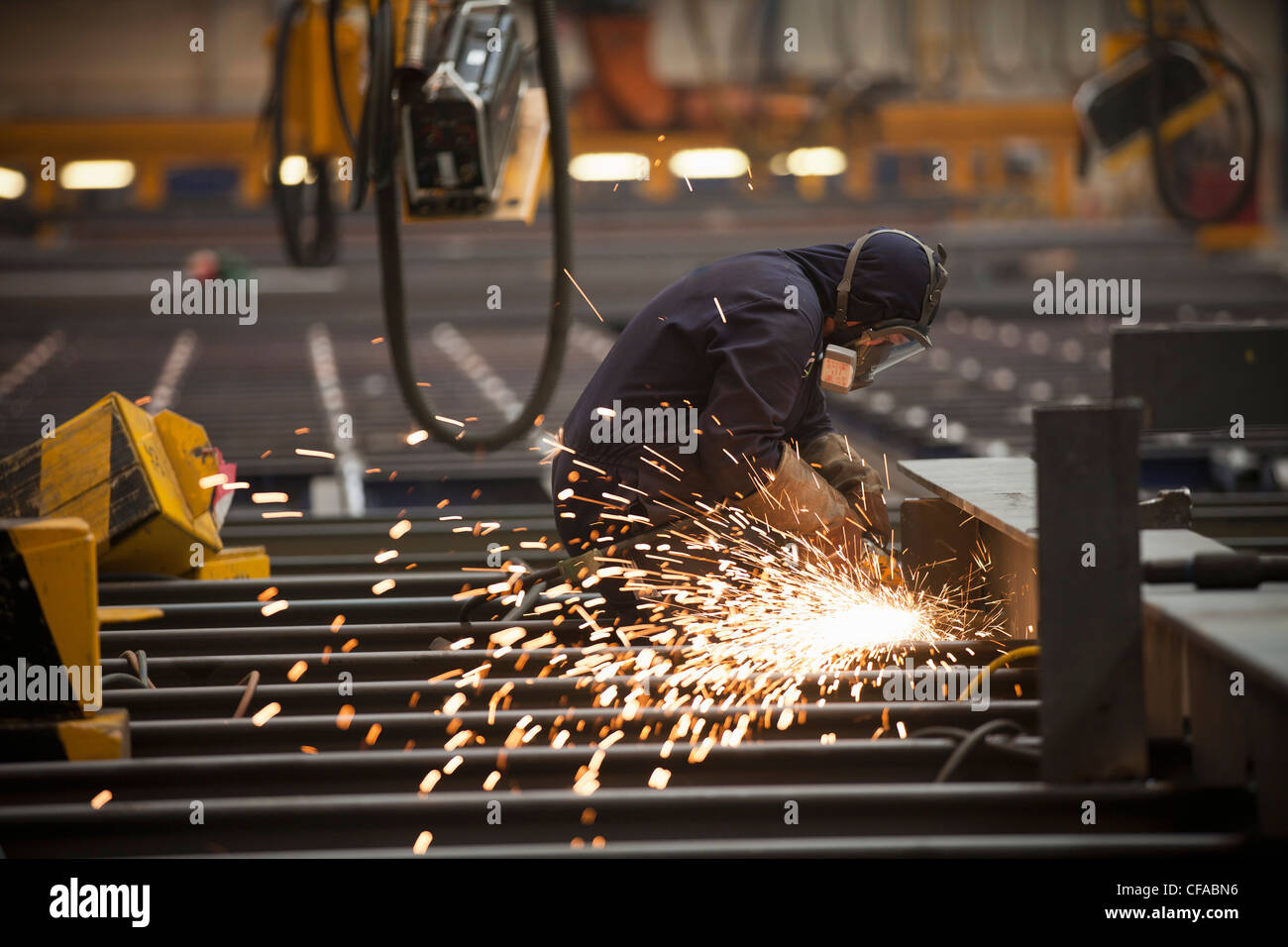 Welder at work in shipyard - Stock Image