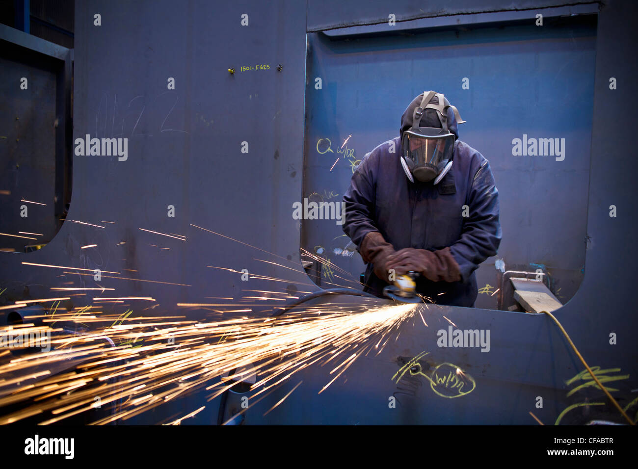 Steel cutter at work in shipyard - Stock Image