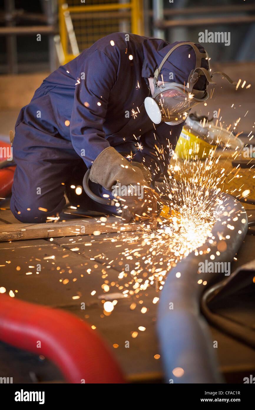 Welder at work in shipyard - Stock Image