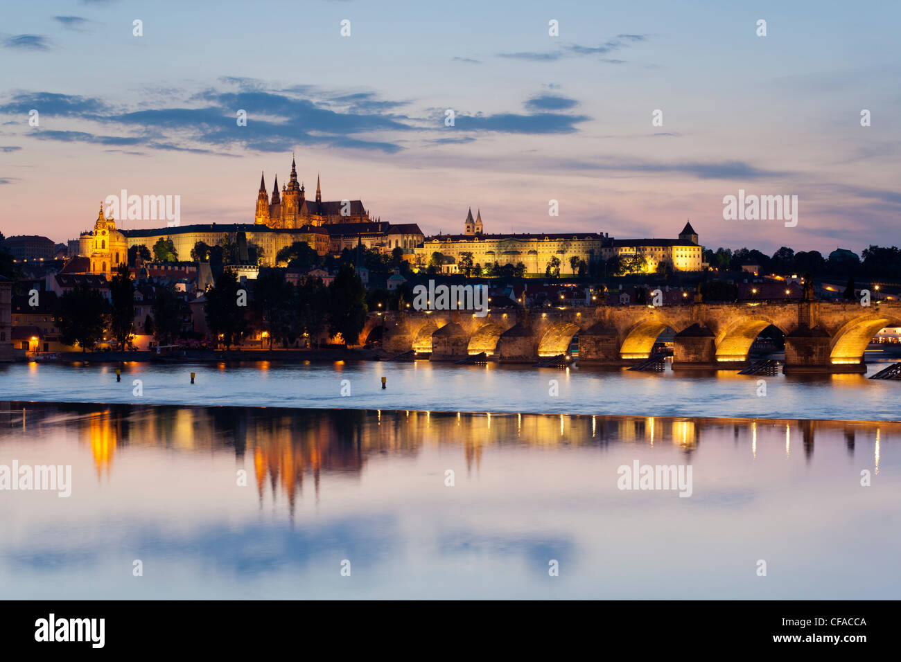 St. Vitus Cathedral, Charles Bridge and the Castle District illuminated at night, Prague, Czech Republic Stock Photo