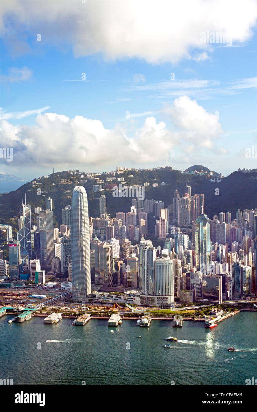 Elevated view across the busy Hong Kong harbour, Central district of Hong Kong Island and Victoria Peak, Hong Kong, - Stock Image