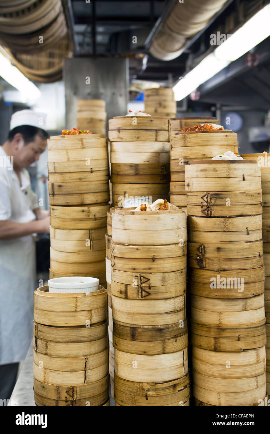 Dim Sum preparation in a restaurant kitchen in Hong Kong, China (MR/PR) - Stock Image
