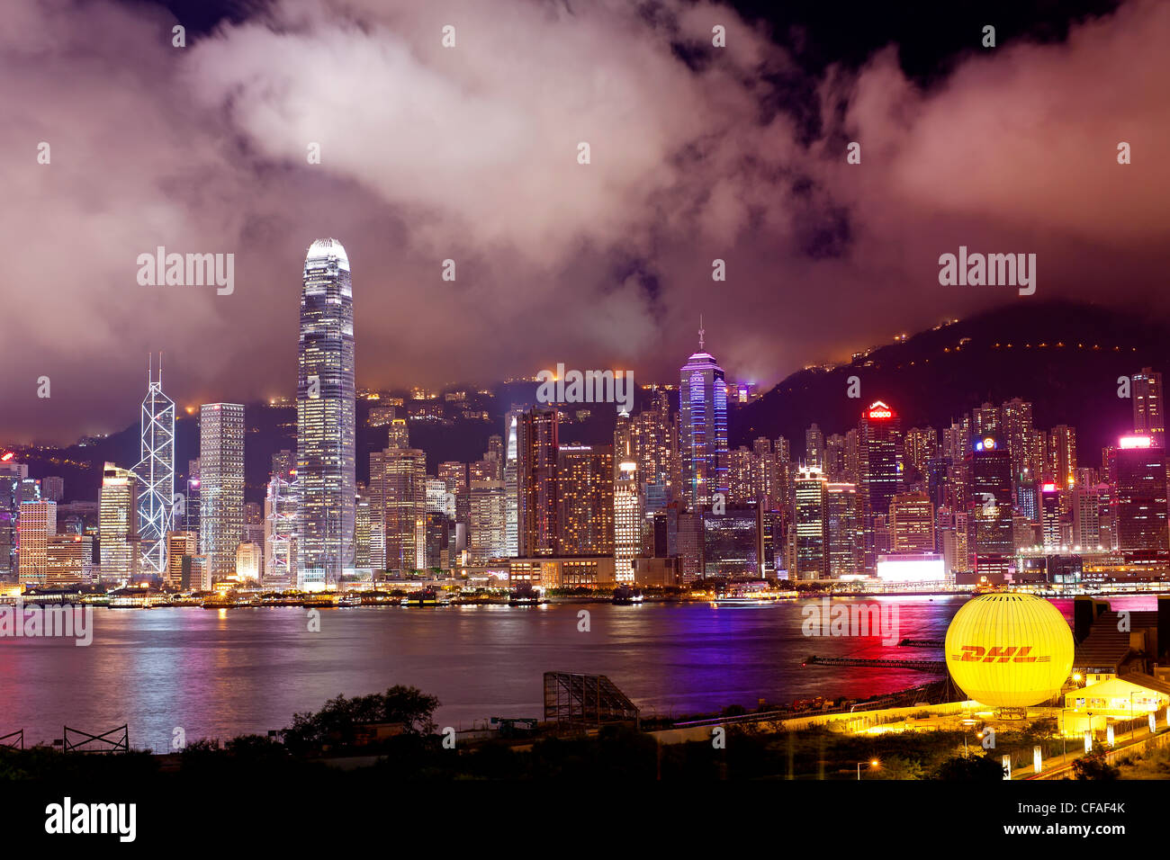 Elevated view across the busy Hong Kong harbour, Central district of Hong Kong Island and Victoria Peak, Hong Kong, Stock Photo