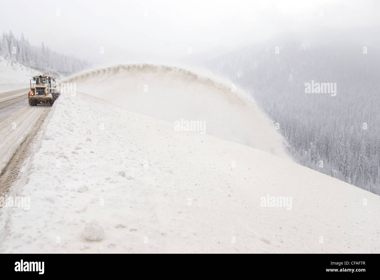 Highway maintenance crew clears road large snow - Stock Image