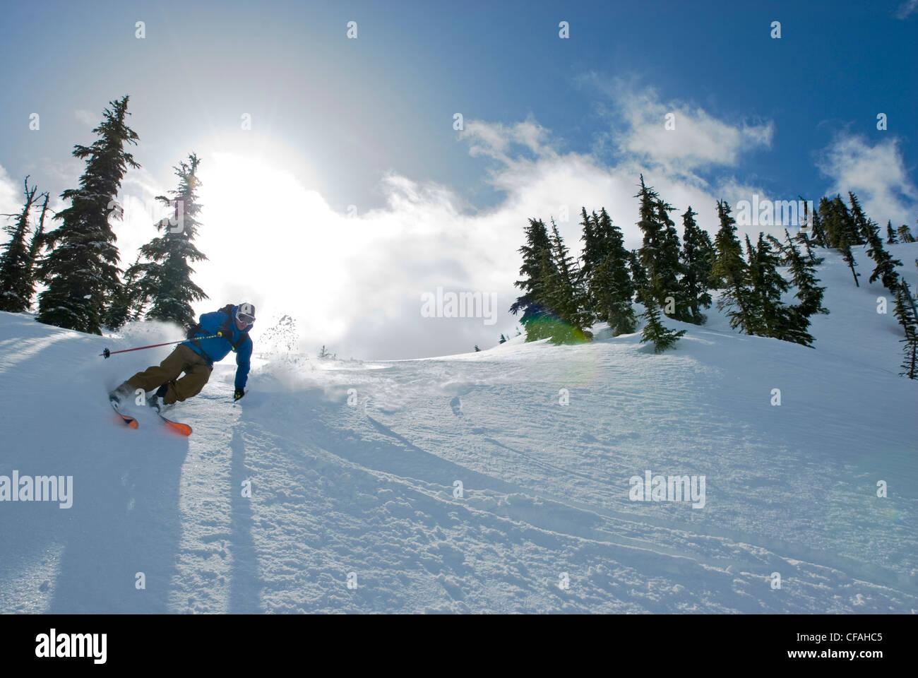 Skier heading down the north side of Iago Peak, Cascade Mountains near the Coquihalla summit, British Columbia, Stock Photo