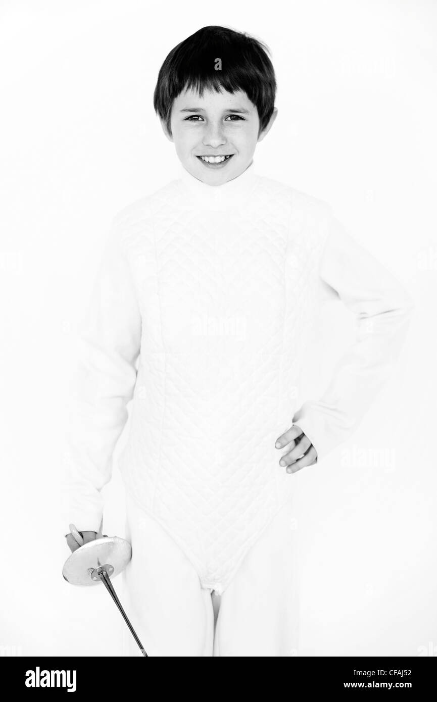 nine year old boy in a fencing outfit against a white background, Montreal, Quebec, Canada. Stock Photo