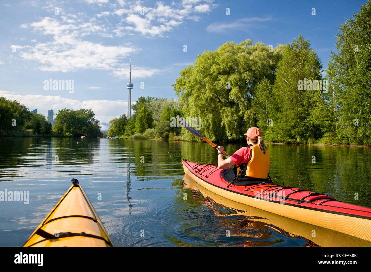 Woman Kayaking By Harbor Stock Photos Amp Woman Kayaking By