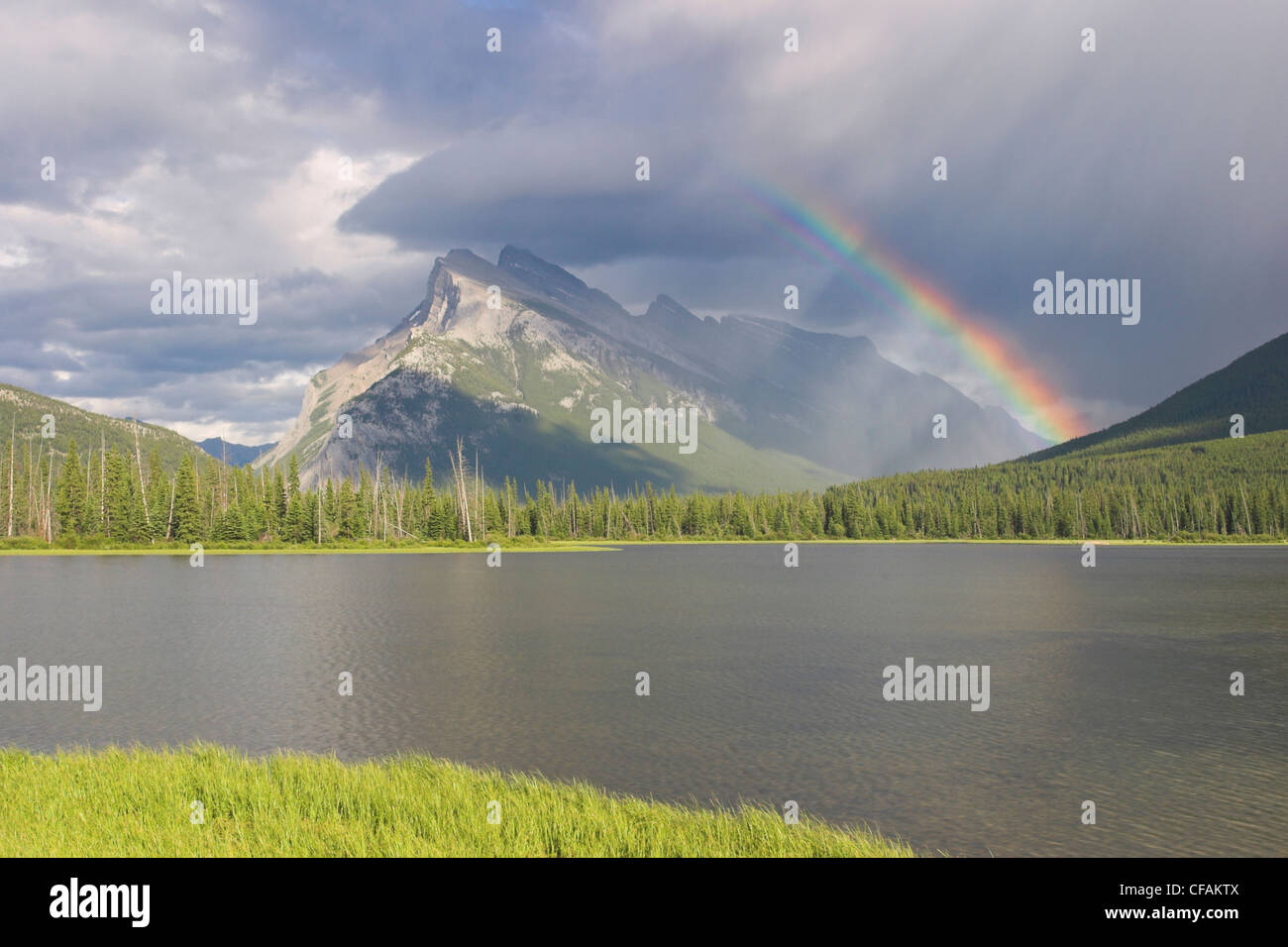 A beautiful rainbow over Mount Rundle in Banff national park, Alberta, Canada Stock Photo