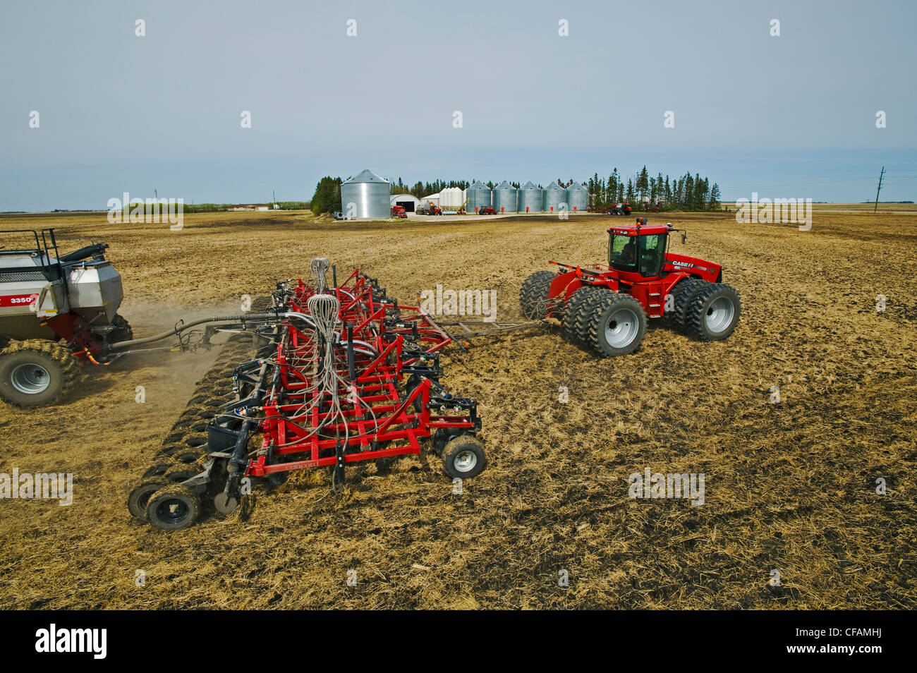 moving tractor and air till seeder planting - Stock Image