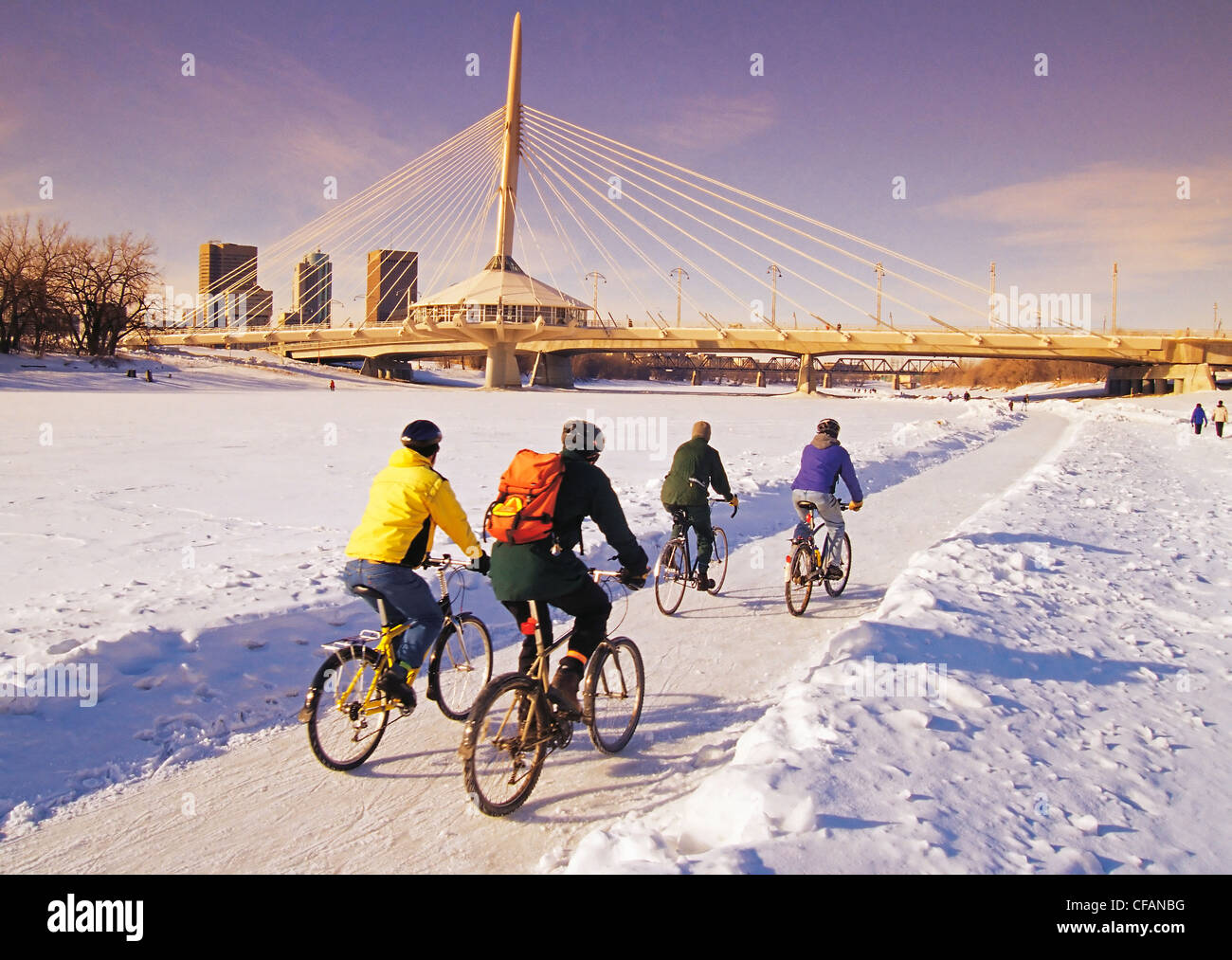 Group people cycling along Winnipeg River Trail - Stock Image