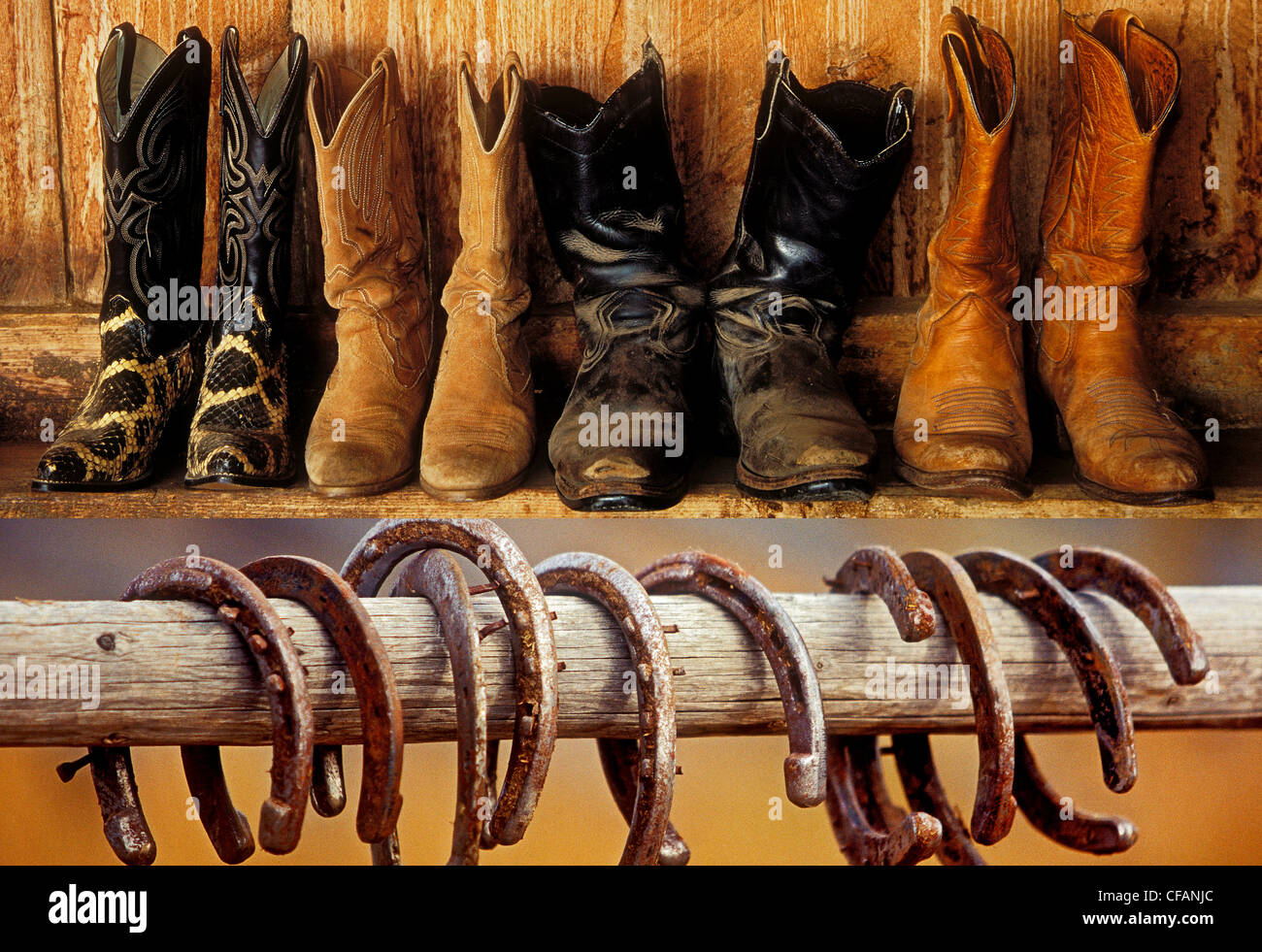 Western motif with cowboy boots and horseshoes on display, British Columbia, Canada - Stock Image