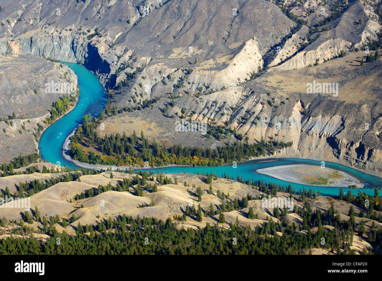 Aerial of Chilcotin River and grasslands in autumn of British Columbia, Canada - Stock Image