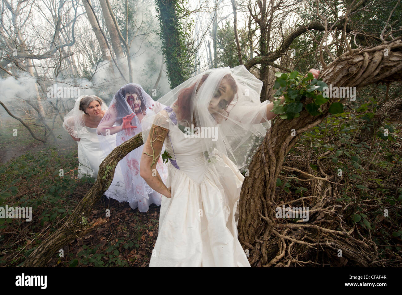 three young women dressed as brides taking part in a Zombie bride ...