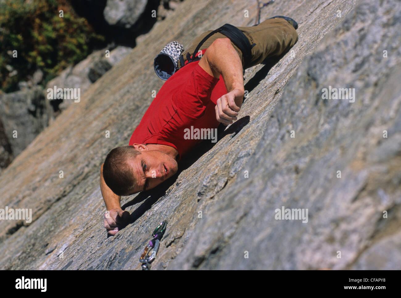 Rock climber, Doug Orr, climbing Naturopath 5.11b on The Doctor's Wall, Skaha Bluffs, Penticton, British Columbia, - Stock Image