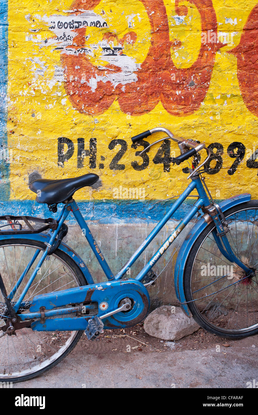 Traditional Indian womans bicycle against a yellow painted wall. Andhra Pradesh, India - Stock Image