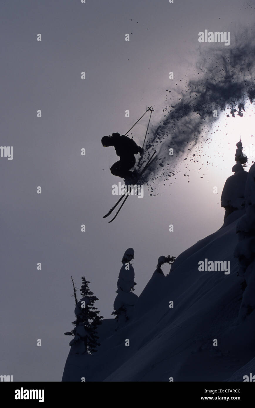 Airborne skier at Kicking Horse Resort, Golden, British Columbia, Canada - Stock Image