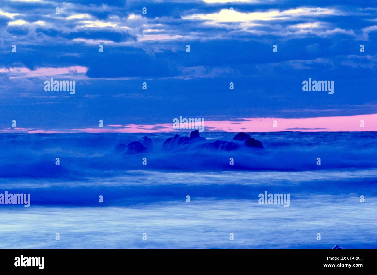 Waves breaking over rocks, Presqu'ille, Cape Breton Highlands National Park, Nova Scotia, Canada. - Stock Image