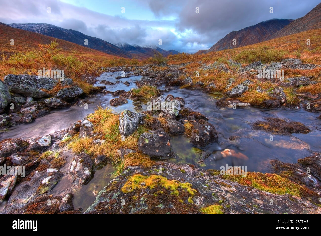 The headwaters of the Klondike River flowing out of Divide Lake, Tombstone Park, Yukon, Canada - Stock Image
