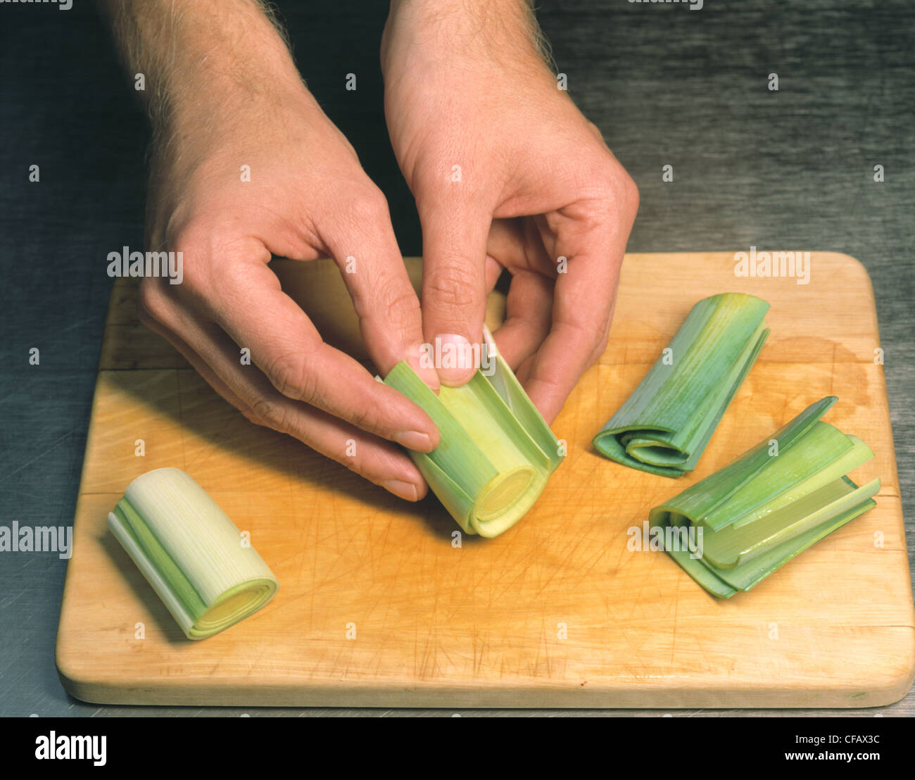 Slitting the leek Stock Photo
