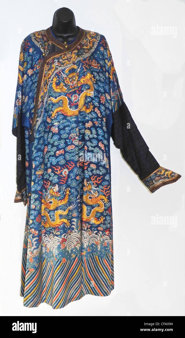 A Chinese Dragon Robe Coat from the Qing Dynasty 19th Century. Woven and embroidered with gold thread and silk depicting - Stock Image