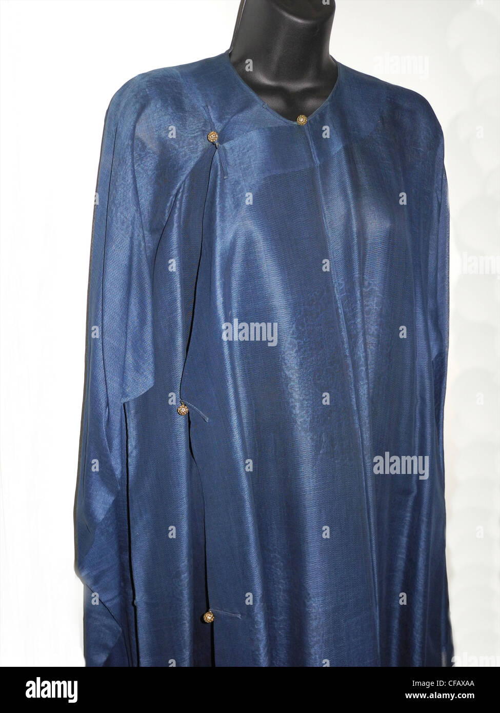 A silk underskirt with gold buttons for a Chinese Dragon Robe from the Qing Dynasty - Stock Image