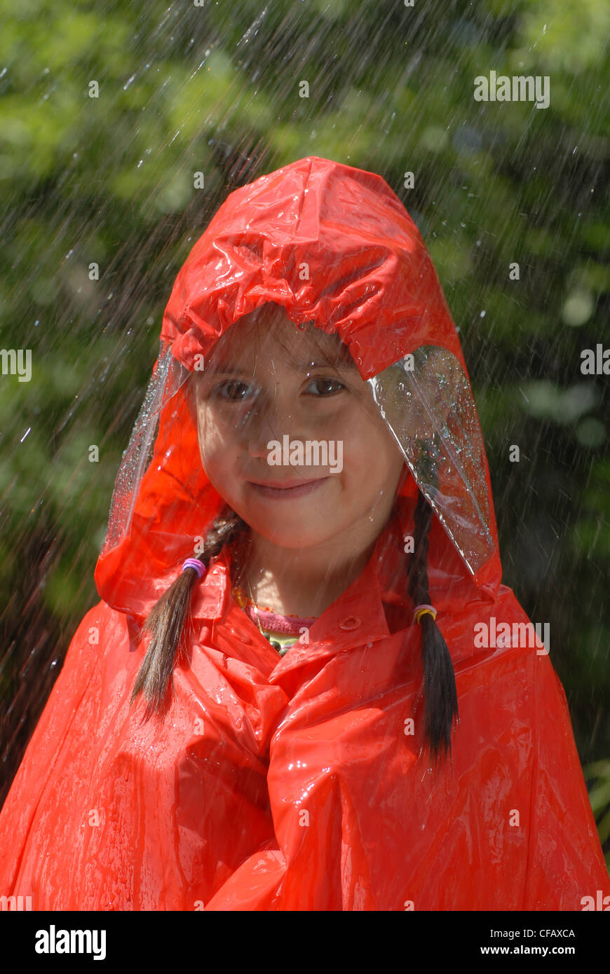 Rains, wetness, water, Autumn, fall, child, girl, orange, weather, rain protection - Stock Image