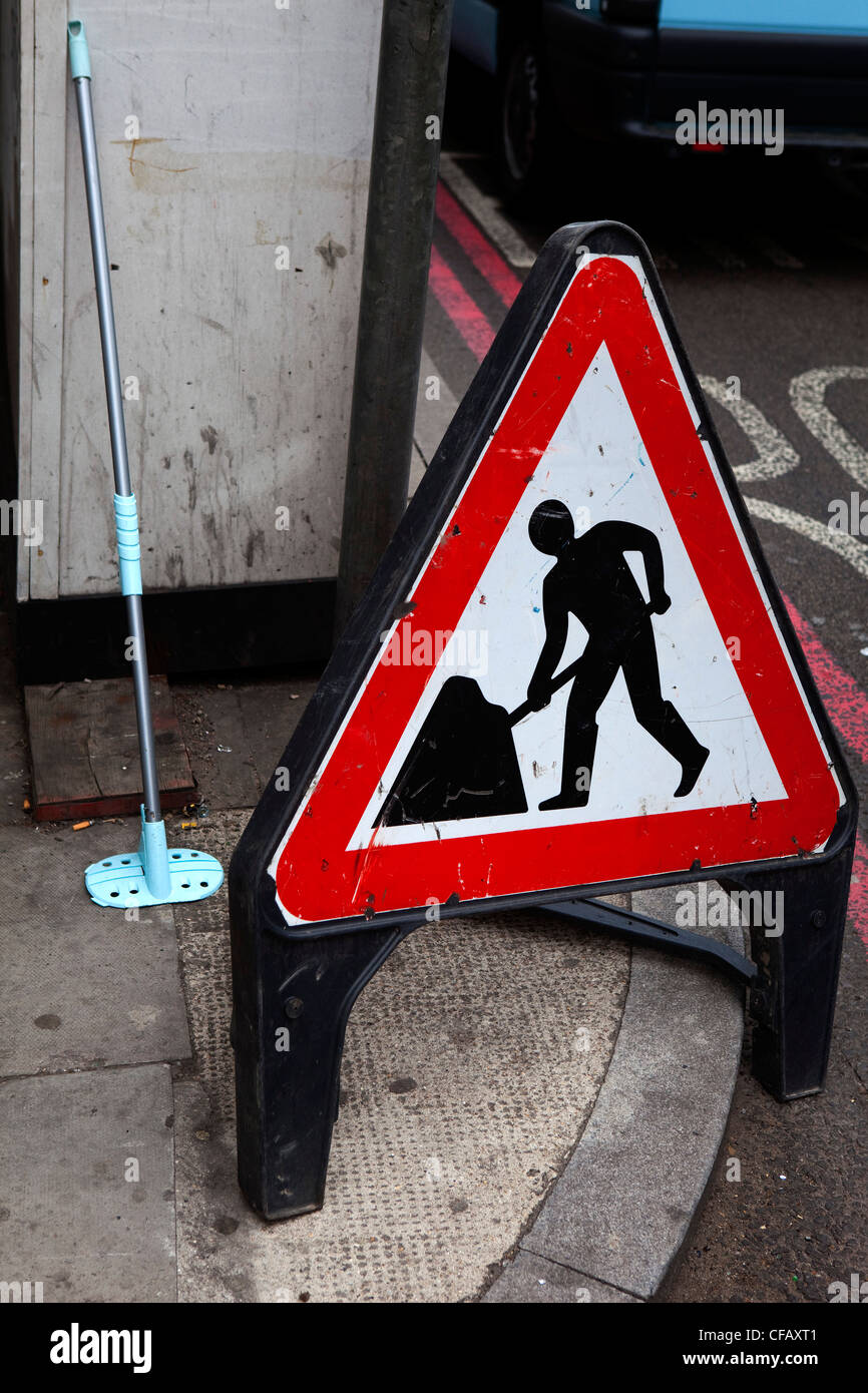 Triangular sign for directing pedestrians around London roadworks - Stock Image