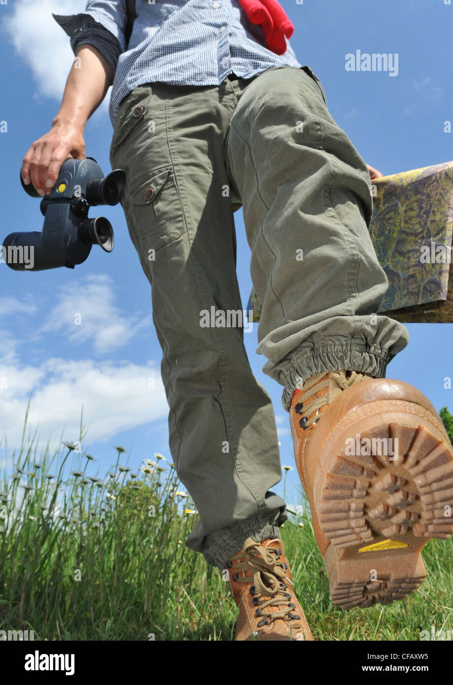 Walking, Hiking, traveller, traveling shoes, profile, map, card, field glasses, meadow, woman, Switzerland - Stock Image