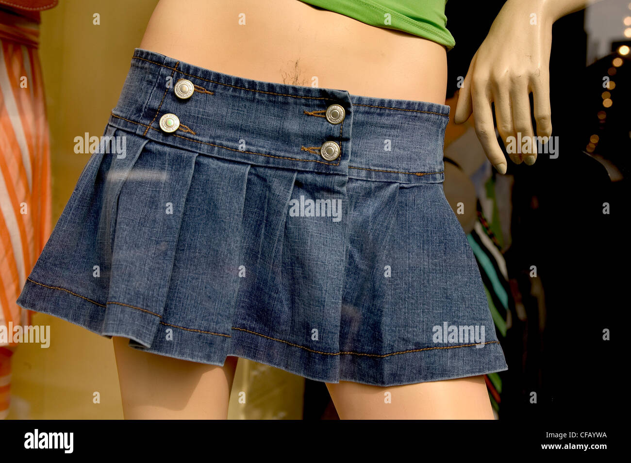 Mannequin of a girls waist and skirt. - Stock Image