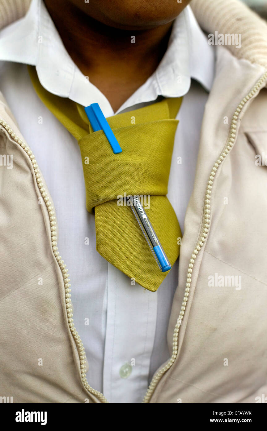 School girl with a biro pen clipped onto her uniform tie - Stock Image