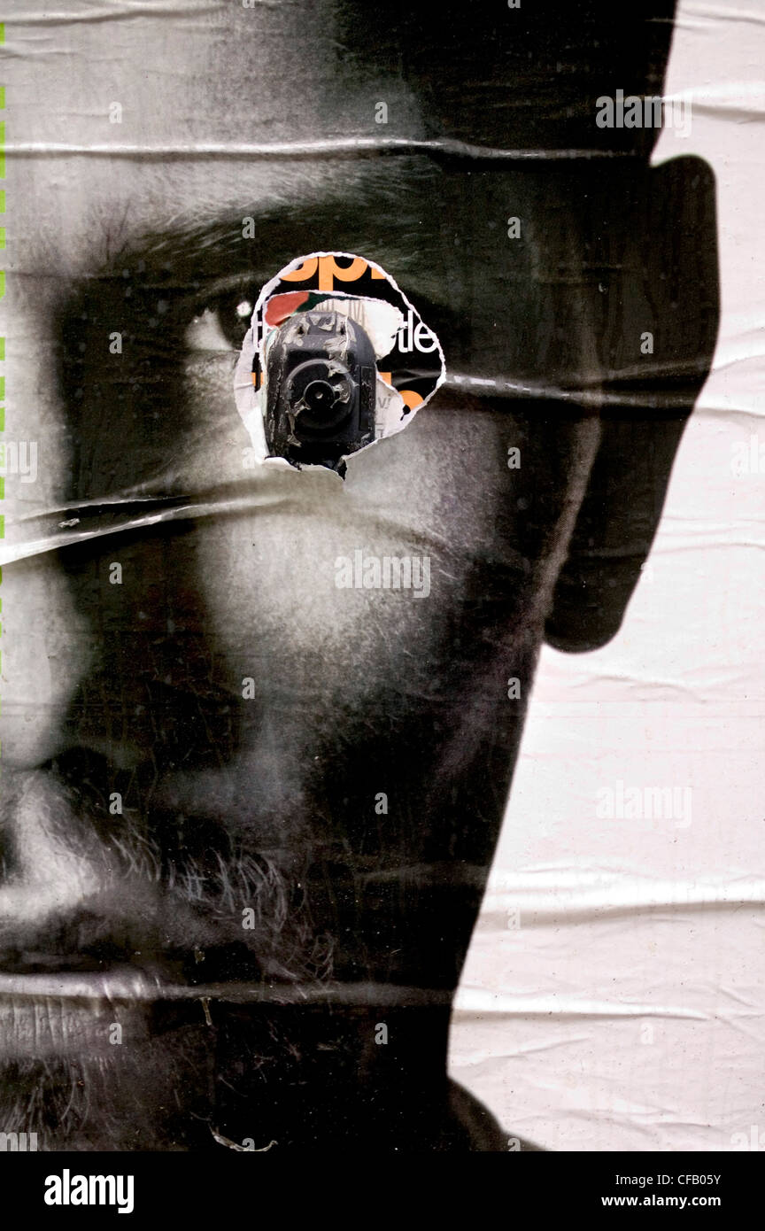 Torn poster of a man's face, New York City. - Stock Image