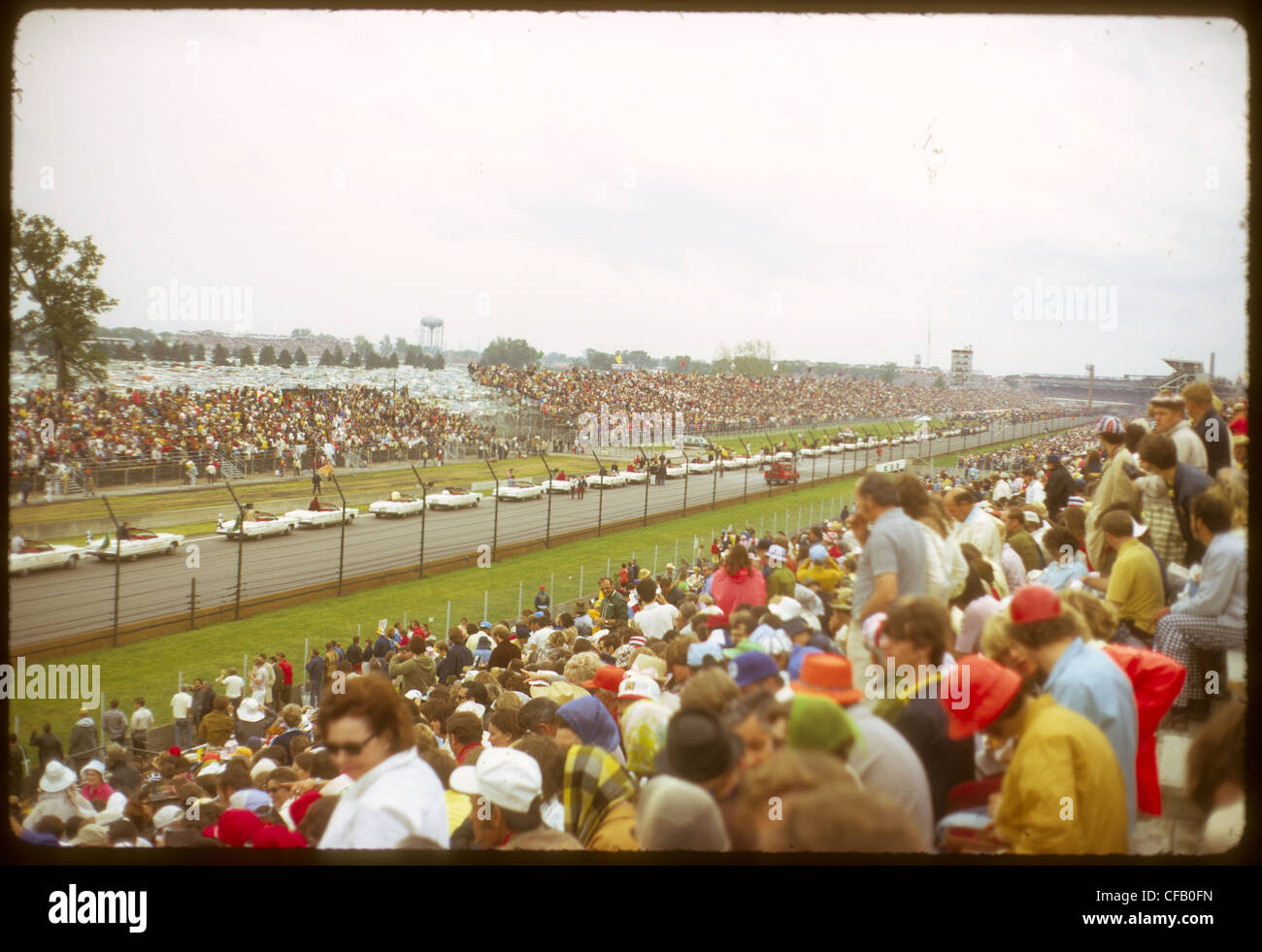 Parade before 1973 Indianapolis 500 track crowd people racing automobile convertibles - Stock Image