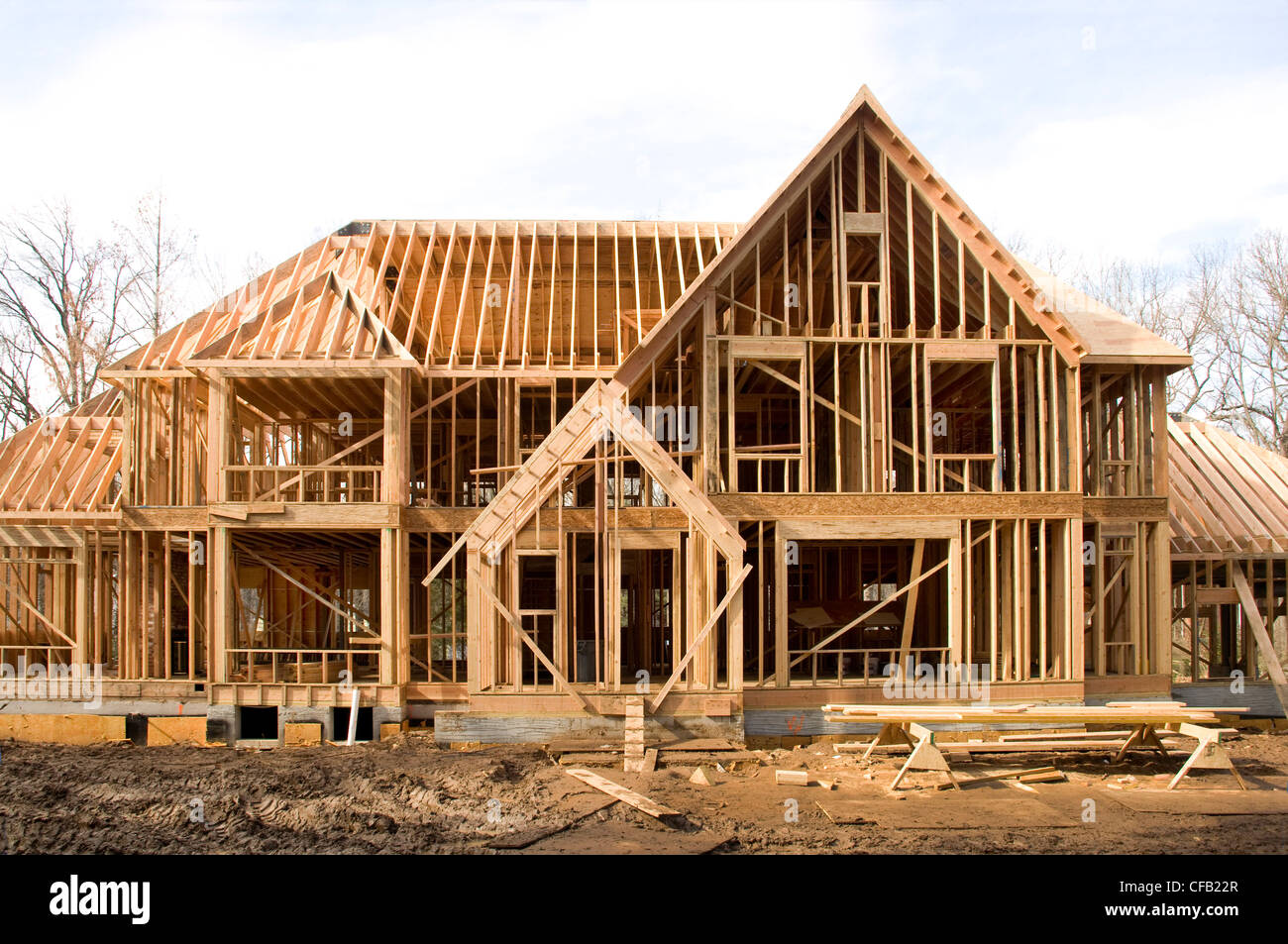 large mcmansion type house under construction in framing phase stock