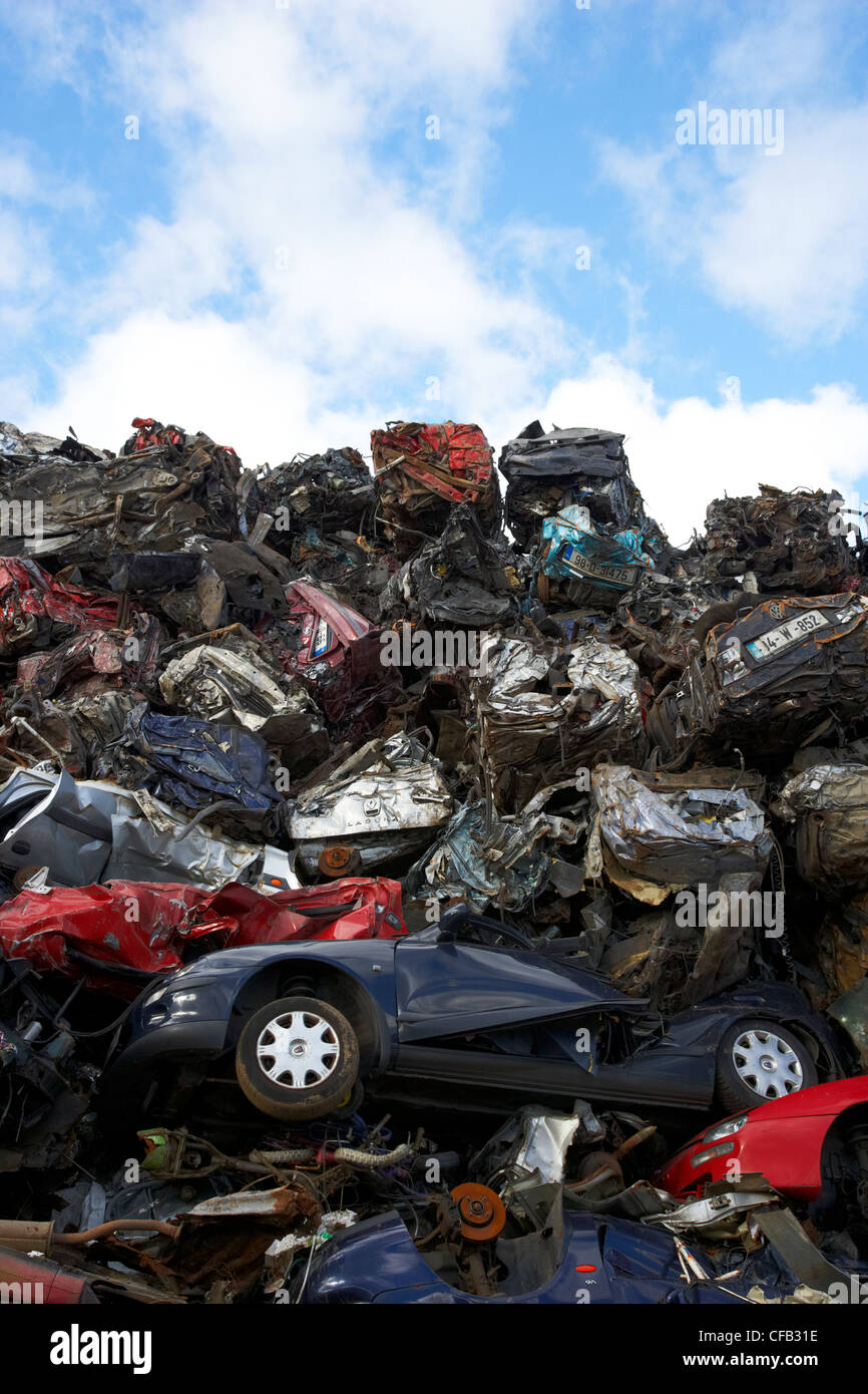 piles of crushed scrapped cars at metal recycling site Belfast Northern Ireland UK Stock Photo