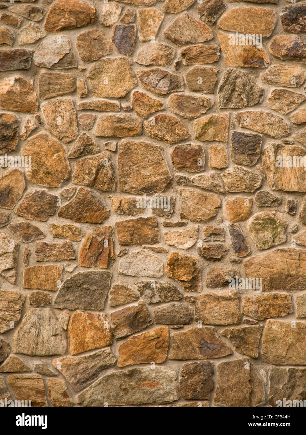 Brown masonry rock wall - Stock Image
