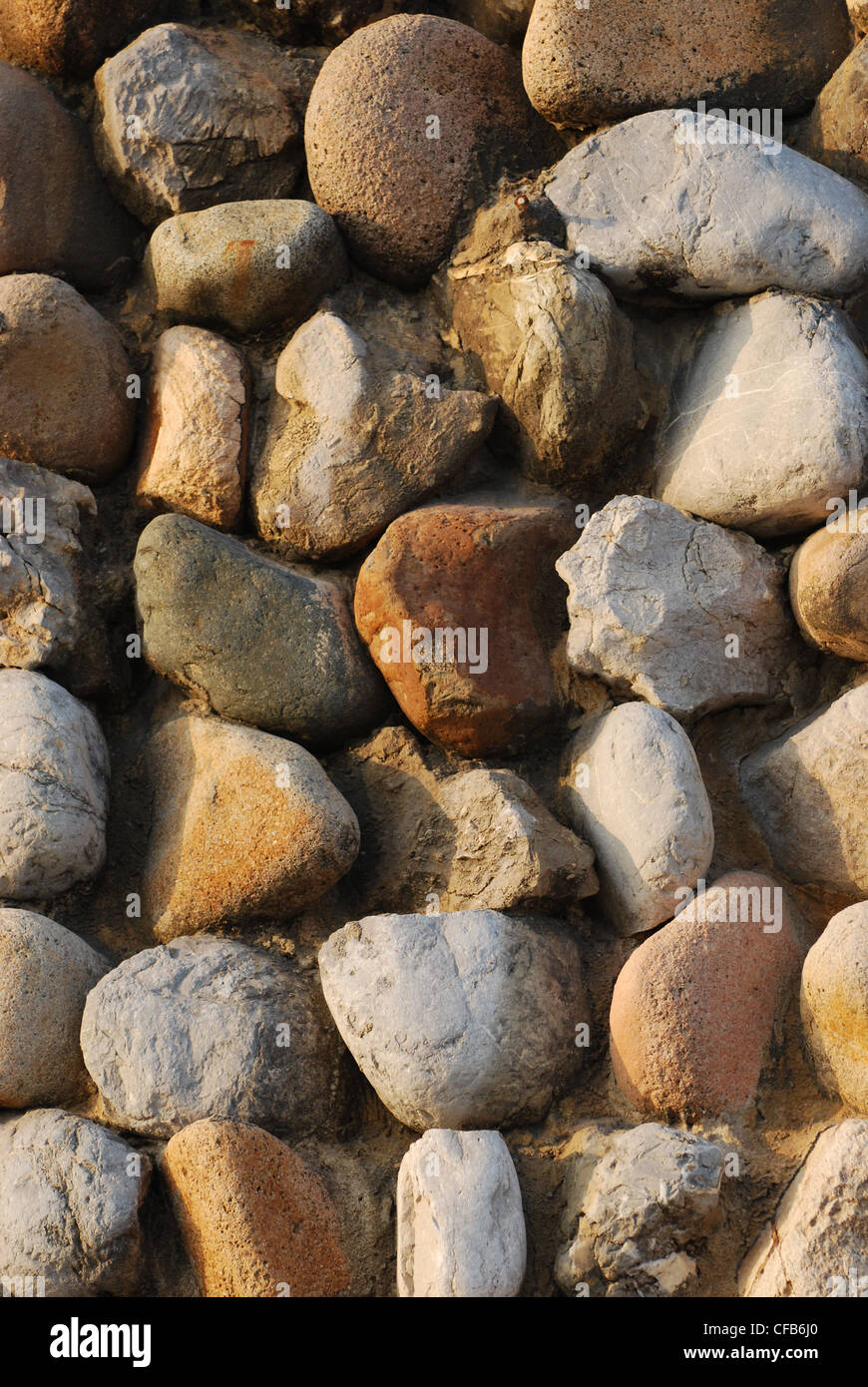 Pebbles on a wall - Stock Image