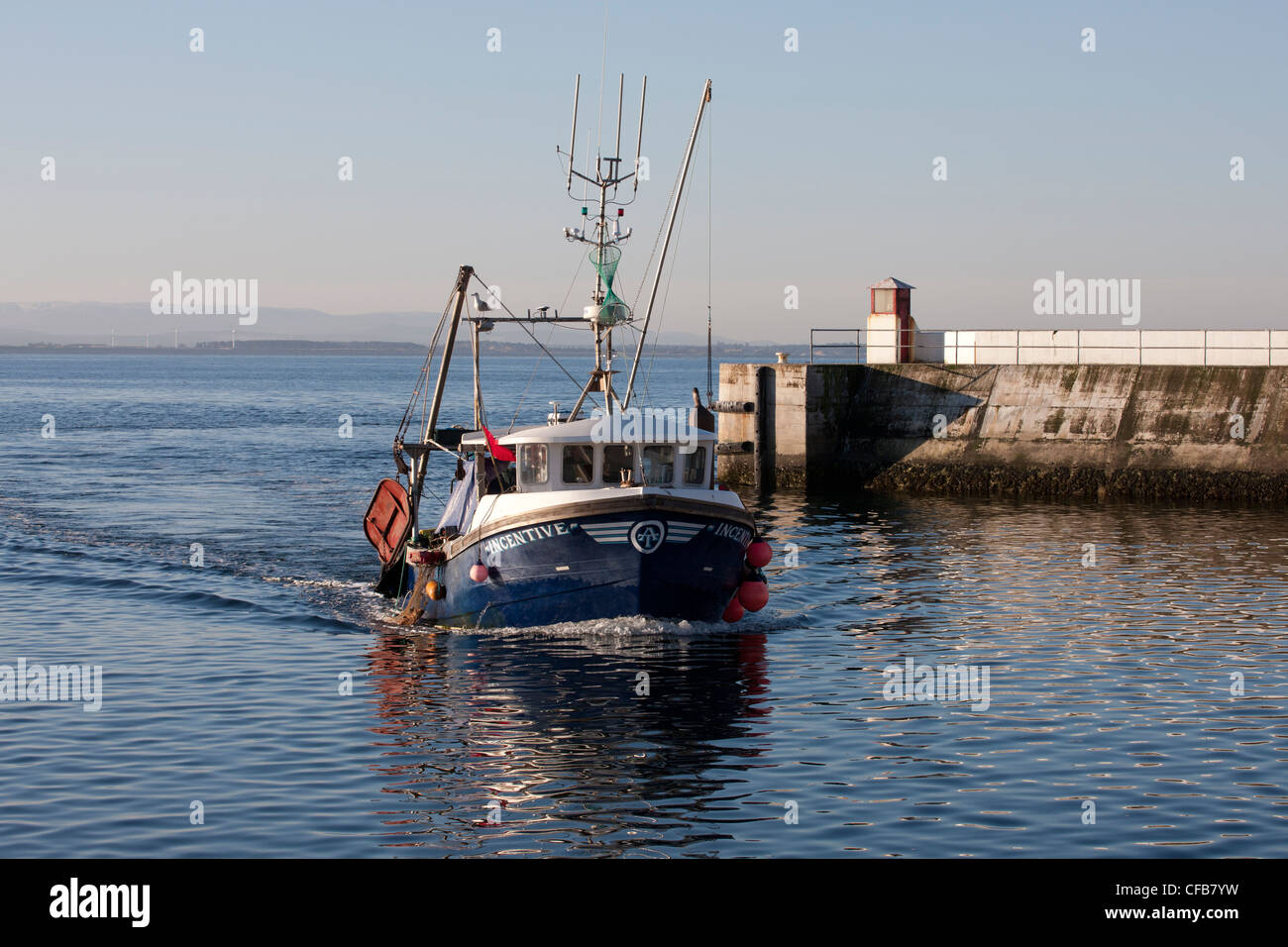Inshore fishing 'Incentive' boat approach entrance to Burghead Harbour on the Moray Firth - Stock Image