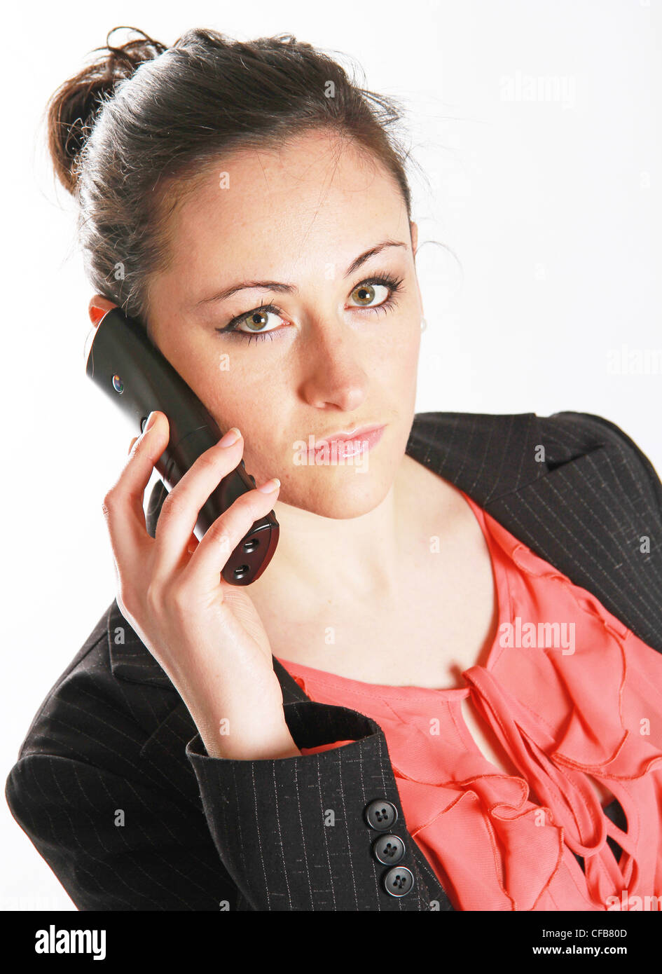 young woman talks on the telephone - Stock Image