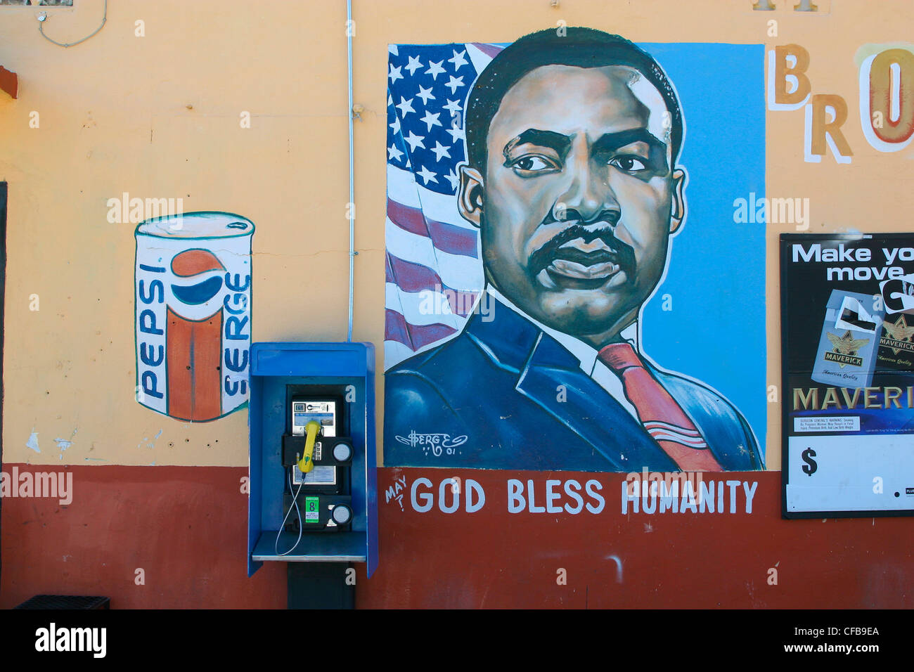 Poster of of painting Martin Luther King with US flag behind him and slogan May God Bless Humanity - Stock Image