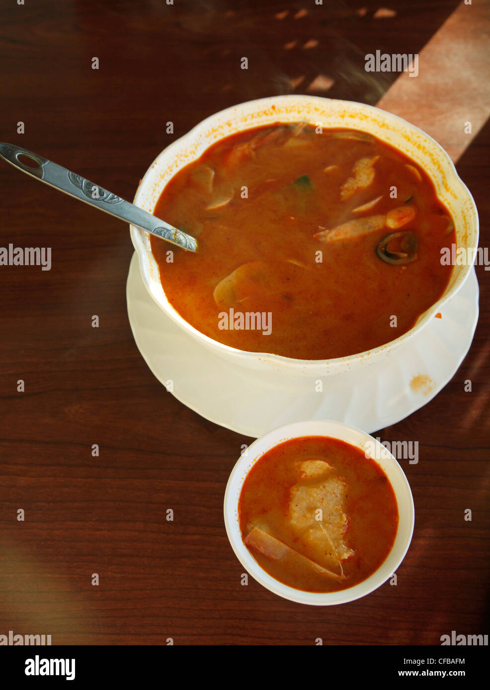 Traditional Tom Yum soup served in a restaurant in Malaysia - Stock Image