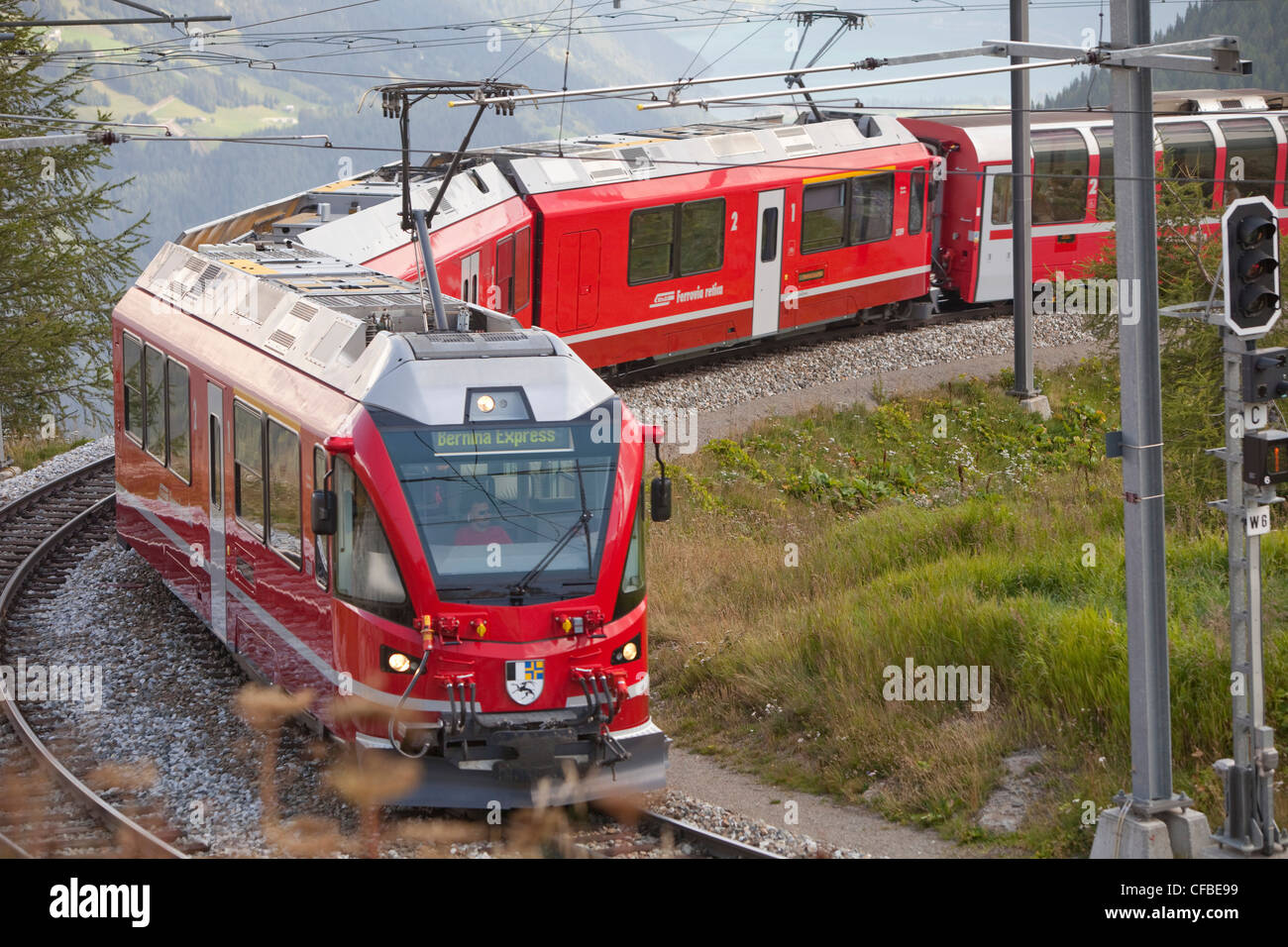 Road, Railway, train, railroad, canton, Graubünden, Grisons, Switzerland, Europe, Rhaetian Railway, Alp Grüm, - Stock Image