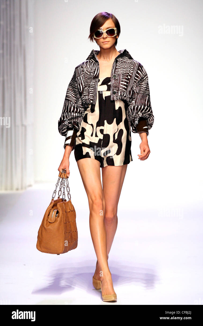 1bb3c5433 Pollini Milan Ready to Wear Spring Summer Black and white tribal tattoo  print cropped jacket puffy sleeves, worn over cow print
