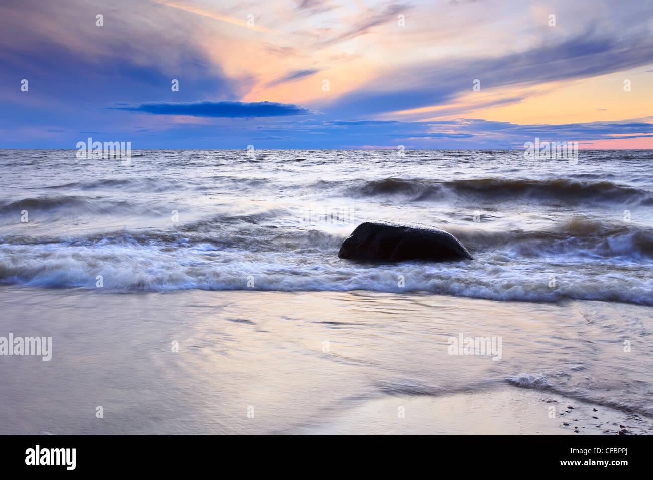 Waves on Lake Winnipeg at sunset. Lester Beach, Manitoba, Canada. - Stock Image