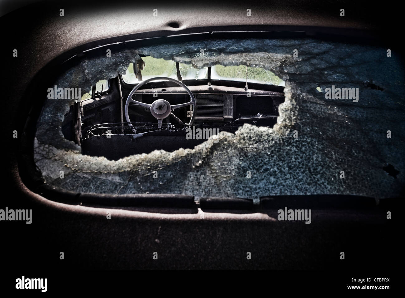 View though old Chevy's smashed rear window, Saskatchewan, Canada - Stock Image
