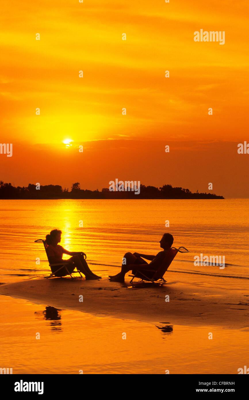 couple on sandbar, Patricia Beach Provincial Park, Lake Winnipeg, Manitoba, Canada - Stock Image