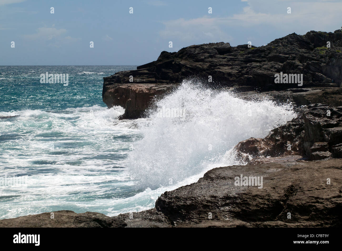 Waves crash into the South shore section of Spittal Pond Nature Reserve, Bermuda - Stock Image