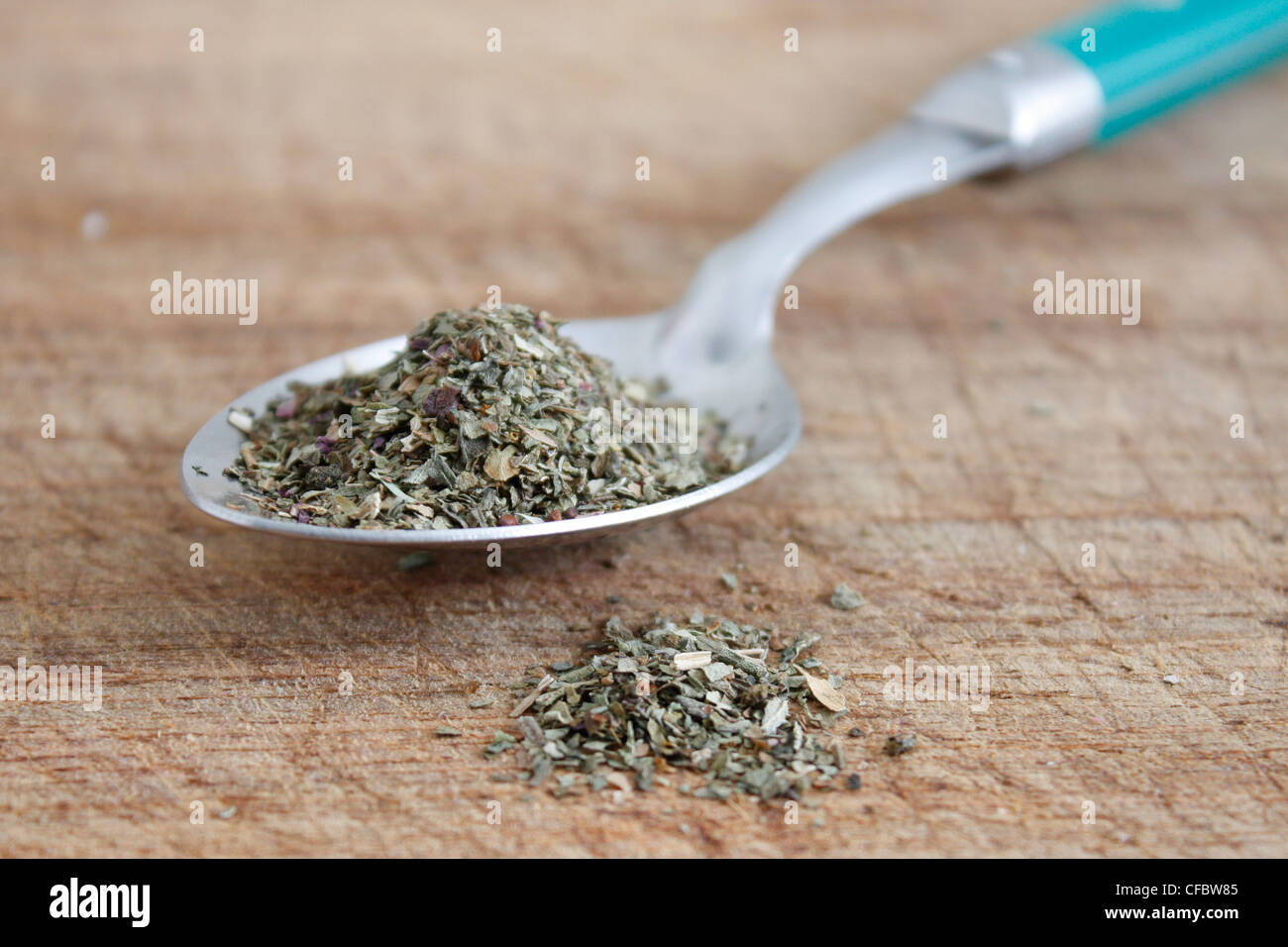 Dried basil on a spoon - Stock Image