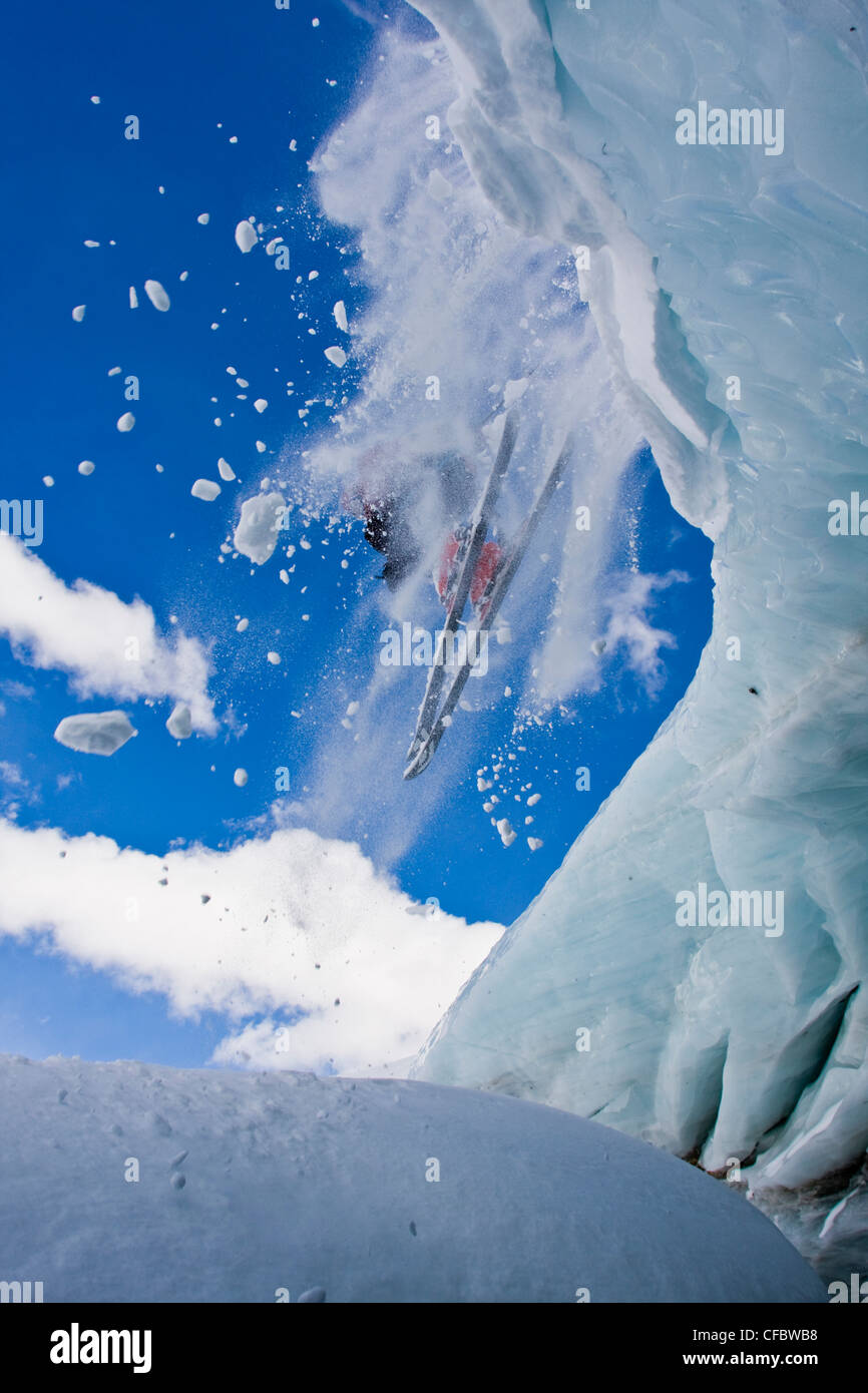 A backcountry skier airs off a crevasse in Mount Assiniboine, Mount Assiniboine Provincial Park, British Columbia, - Stock Image