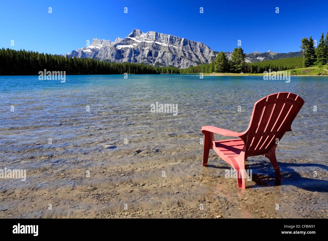 Deck chair at Two Jack Lake, Banff National Park, Alberta, Canada Stock Photo
