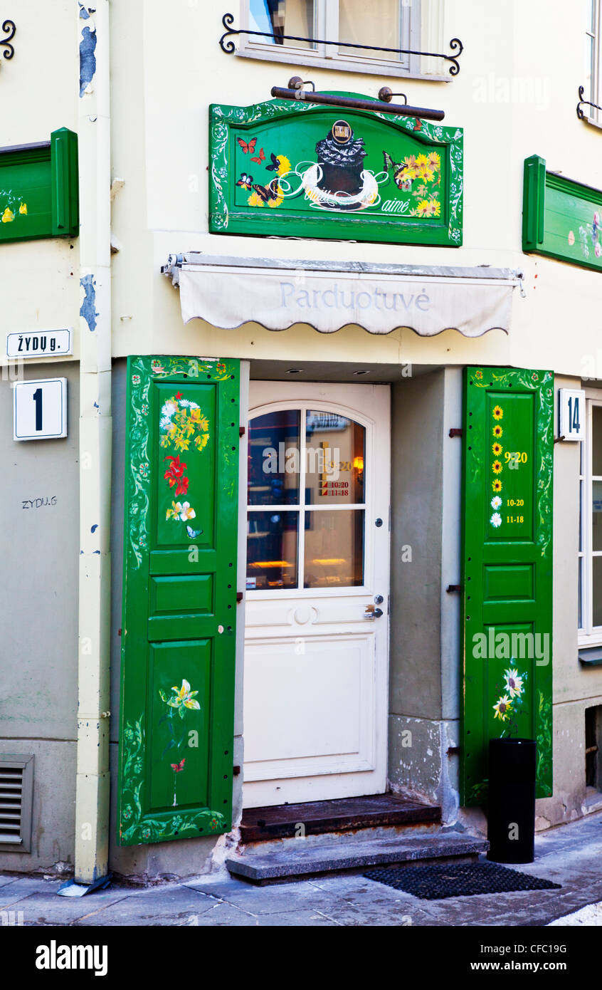 Restaurant with colourfully painted wooden shutters at its entrance in Vilnius, Lithuania Stock Photo